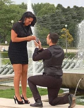 Ryan Debolt on knees, proposing Sara Ramirez